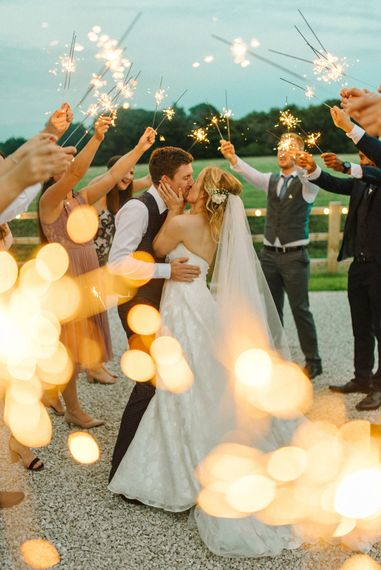 Sparklers   Bride in Strapless Sassi Holford Ballgown Wedding Dress with Belt   Groom in Blue Check Paul Smith Suit   Hazel Gap Barn Wedding with Bride Arriving by Kit Car   Sarah-Jane Ethan Photography
