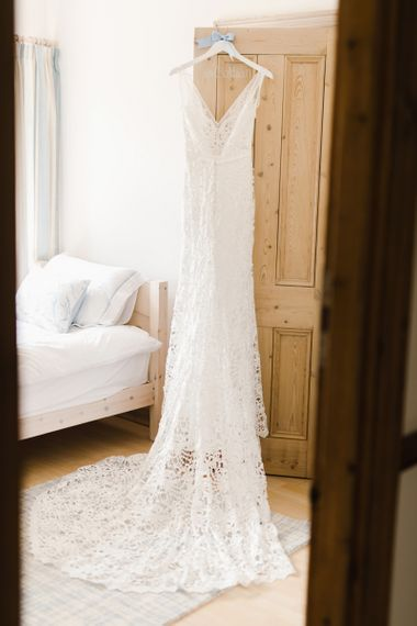 Wedding Dress Hanging Up Ready for Bride