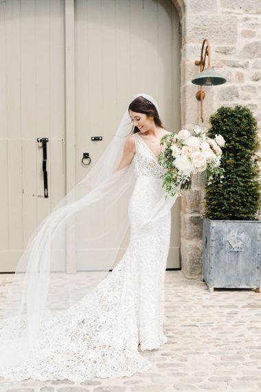 Bride wearing Veil Holding Beautiful Wedding Bouquet