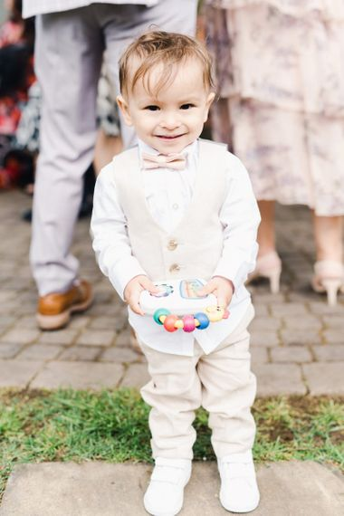 Young Boy Wedding Guest In Cream Suit and Bow Tie