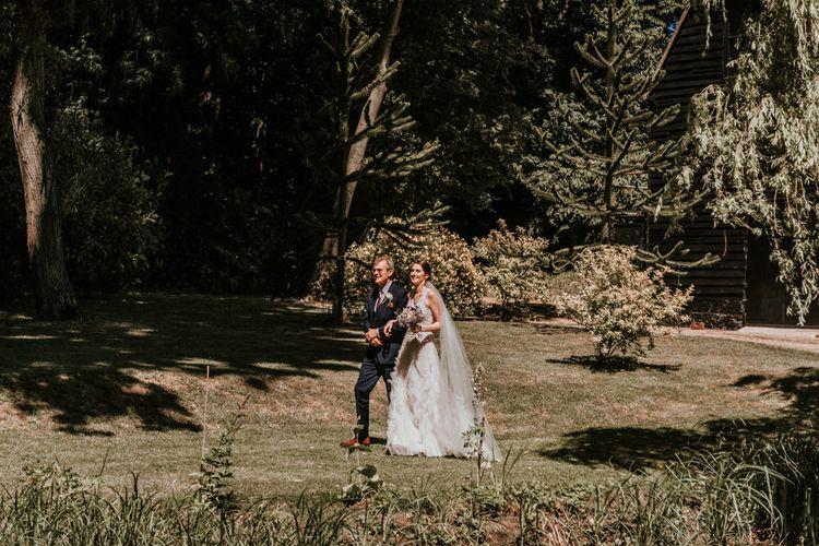 Outdoor Wedding Ceremony Bridal Entrance  in Pronovias Danaia Wedding Dress