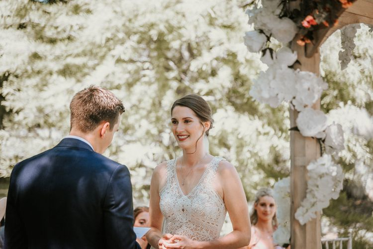Wedding Ceremony with Bride in Pronovias Danaia Wedding Dress and Groom in Navy Moss Bros. Suit