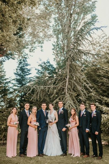 Wedding Party Portrait with Bridesmaids in Pink Dresses, Bride in Pronovias Wedding Dress and Groomsmen in Navy Suits