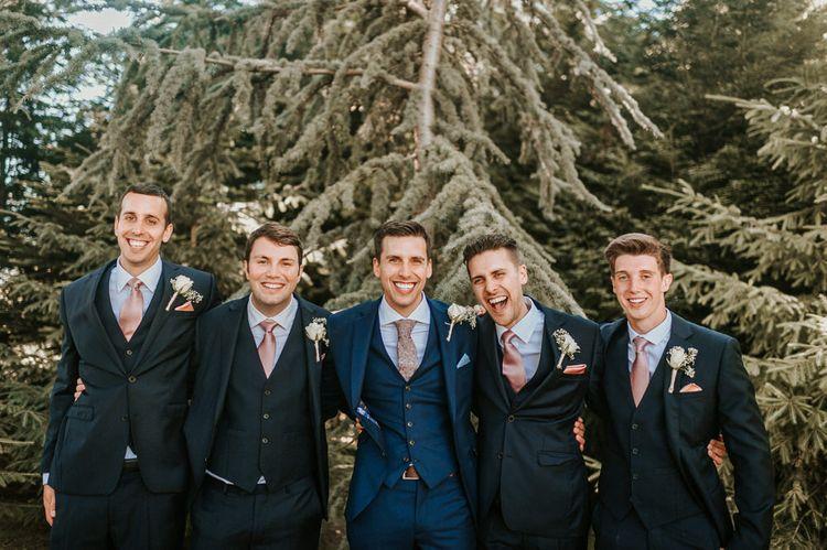 Groomsmen Portrait with Men in Navy Moss Bros. Suits