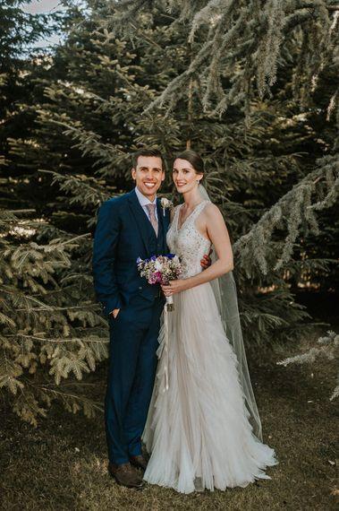 Portrait of Bride in Pronovias Danaia Wedding Dress and Groom in Navy Moss Bros. Suits