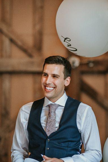 Smiley Groom in Navy Waistcoat and Paisley Tie
