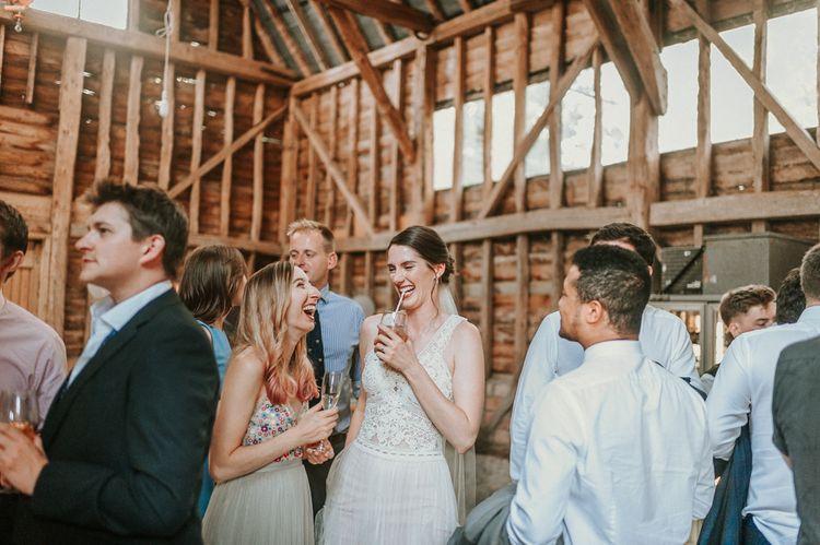 Bride in Pronovias Danaia Wedding Dress Enjoying Drinks Reception in Barn