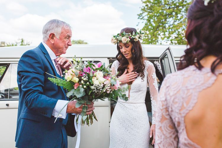 Bridal Entrance in Long Lace Sleeve Mikaella Bridal Gown | Spring, Boho, Festival Themed Wedding with Flower Crowns, Pastel Flowers & Street Food Vans at  Painshill Park, Surrey | Kirsty Mackenzie Photography | Alice Underwood Films