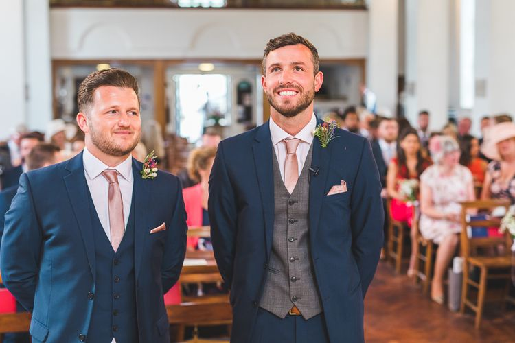 Groom at the Altar in Moss Bros Suit | Spring, Boho, Festival Themed Wedding with Flower Crowns, Pastel Flowers & Street Food Vans at  Painshill Park, Surrey | Kirsty Mackenzie Photography | Alice Underwood Films