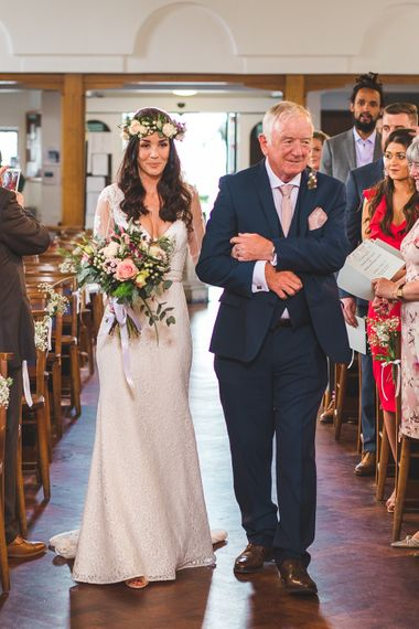 Church Ceremony | Bridal Entrance in Long Lace Sleeve Mikaella Bridal Gown | Spring, Boho, Festival Themed Wedding with Flower Crowns, Pastel Flowers & Street Food Vans at  Painshill Park, Surrey | Kirsty Mackenzie Photography | Alice Underwood Films