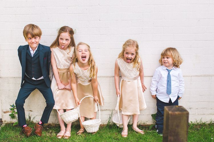 Flower Girls & Page Boys | Spring, Boho, Festival Themed Wedding with Flower Crowns, Pastel Flowers & Street Food Vans at  Painshill Park, Surrey | Kirsty Mackenzie Photography | Alice Underwood Films