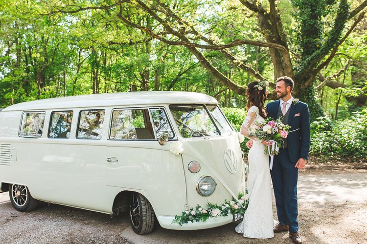 VW Camper Van | Bride in Long Lace Sleeve Mikaella Bridal Gown & Flower Crown | Groom in Navy Moss Bros Suit | Spring, Boho, Festival Themed Wedding with Flower Crowns, Pastel Flowers & Street Food Vans at  Painshill Park, Surrey | Kirsty Mackenzie Photography | Alice Underwood Films