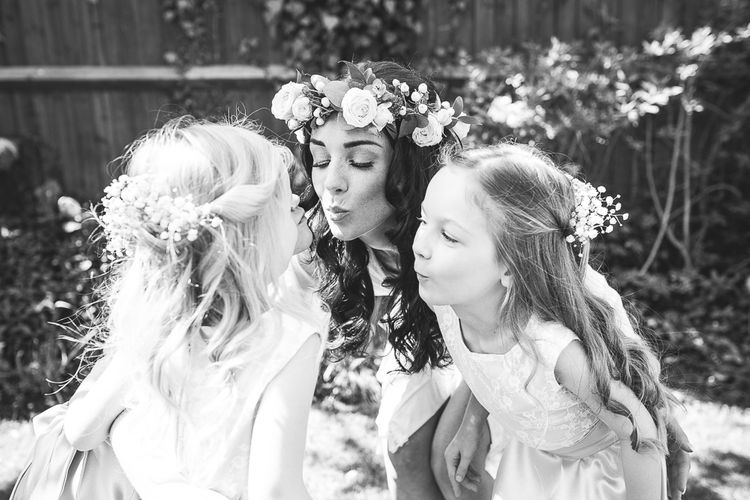 Bride & Flower Girls | Spring, Boho, Festival Themed Wedding with Flower Crowns, Pastel Flowers & Street Food Vans at  Painshill Park, Surrey | Kirsty Mackenzie Photography | Alice Underwood Films