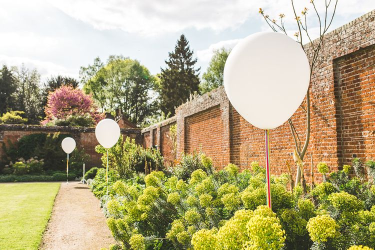 Giant Balloons Wedding Decor | Spring, Boho, Festival Themed Wedding with Flower Crowns, Pastel Flowers & Street Food Vans at  Painshill Park, Surrey | Kirsty Mackenzie Photography | Alice Underwood Films