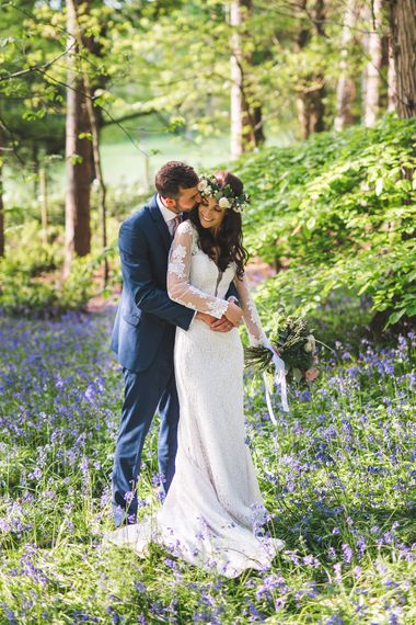 Bride in Long Lace Sleeve Mikaella Bridal Gown & Flower Crown | Groom in Navy Moss Bros Suit | Spring, Boho, Festival Themed Wedding with Flower Crowns, Pastel Flowers & Street Food Vans at  Painshill Park, Surrey | Kirsty Mackenzie Photography | Alice Underwood Films