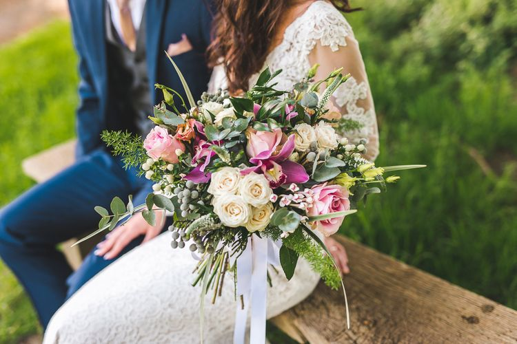 Pink & White Spring Bridal Bouquet | Bride in Long Lace Sleeve Mikaella Bridal Gown & Flower Crown | Groom in Navy Moss Bros Suit | Spring, Boho, Festival Themed Wedding with Flower Crowns, Pastel Flowers & Street Food Vans at  Painshill Park, Surrey | Kirsty Mackenzie Photography | Alice Underwood Films
