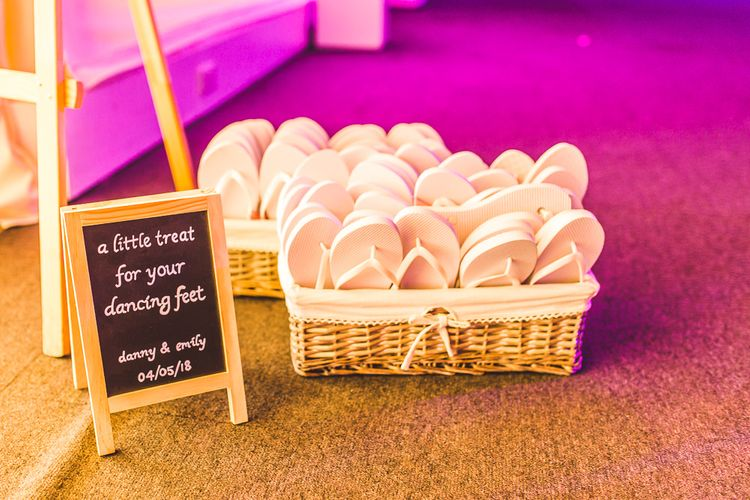 Flip Flops in a Basket | Wedding Ideas | Spring, Boho, Festival Themed Wedding with Flower Crowns, Pastel Flowers & Street Food Vans at  Painshill Park, Surrey | Kirsty Mackenzie Photography | Alice Underwood Films