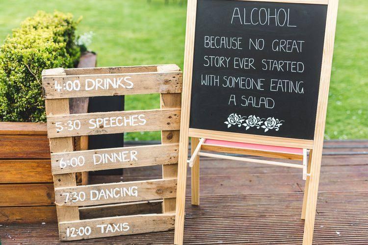 Chalkboard & Wooden Palette Wedding Signs | Spring, Boho, Festival Themed Wedding with Flower Crowns, Pastel Flowers & Street Food Vans at  Painshill Park, Surrey | Kirsty Mackenzie Photography | Alice Underwood Films