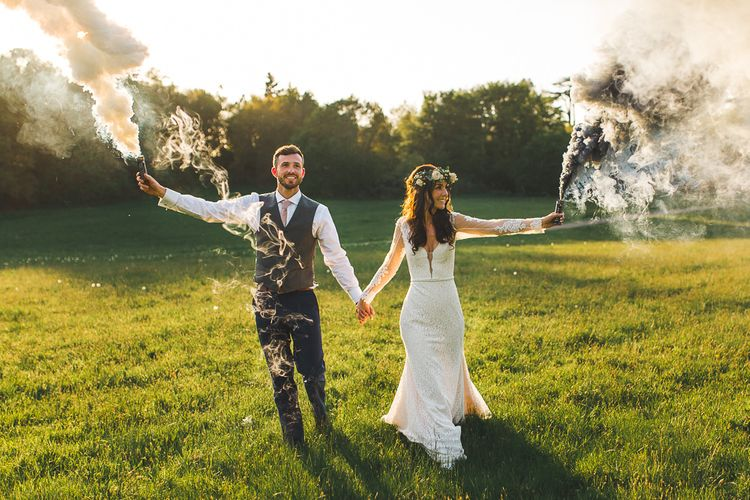 Smoke Bomb Portrait | Bride in Long Lace Sleeve Mikaella Bridal Gown & Flower Crown | Groom in Navy Moss Bros Suit | Spring, Boho, Festival Themed Wedding with Flower Crowns, Pastel Flowers & Street Food Vans at  Painshill Park, Surrey | Kirsty Mackenzie Photography | Alice Underwood Films