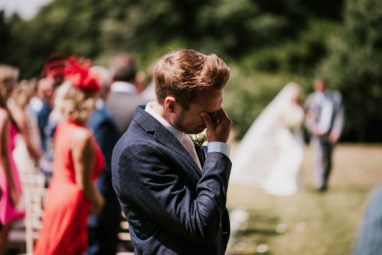 Emotional Groom in Check Moss Bros. Suit at the Altar