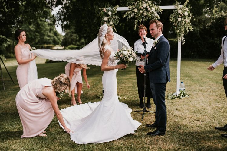 Wedding Ceremony with Bride in Pronovias Wedding Dress and Groom in Moss Bros. Suit