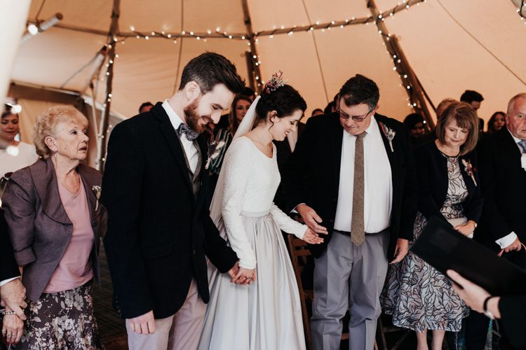 Tipi Wedding Ceremony with Bride in Silver Skirt and Groom in Pink Chinos