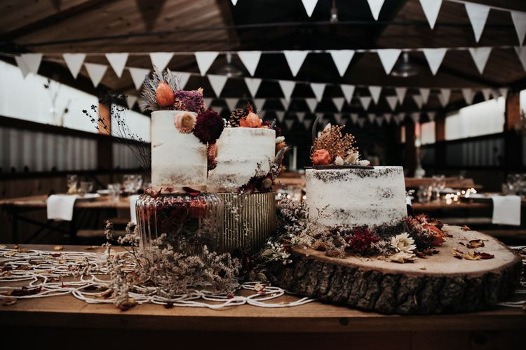 Rustic Wedding Cake Display with Tree Slice Cake Stand and Semi Naked Wedding Cake