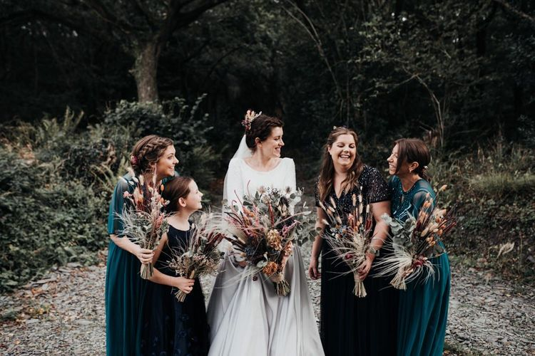 Bridal Party Portrait in the Forest with Green and Navy Dresses and Dried Flower Wedding Bouquets