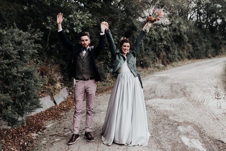 Bride in Mila Mira Separates with Silver Skirt and Leather Jacket and Groom in Pink Chinos, Wool Waistcoat and Navy Blazer