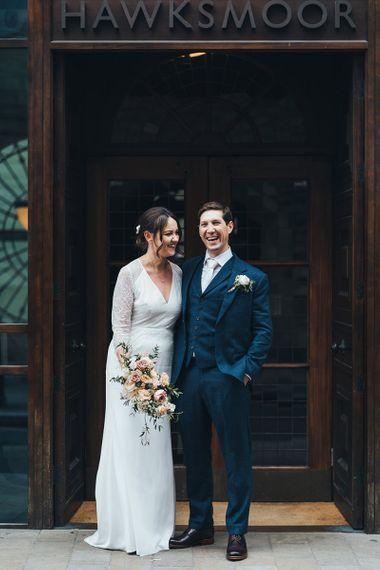 Bride and Groom in Navy Three Piece Suit