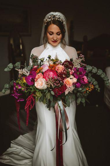Bride in Bespoke Wedding Dress Holding a Pink Wedding Bouquet