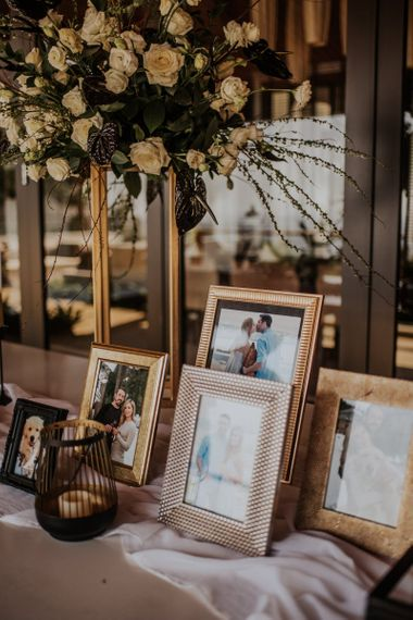 Personal wedding welcome table with photographs in frames