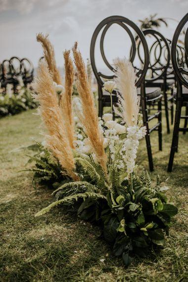 Pampas grass wedding decor at outdoor ceremony