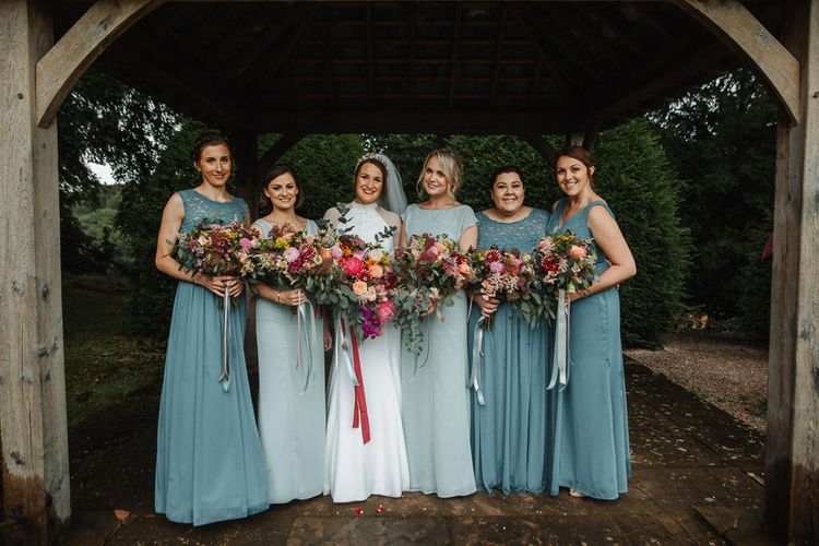 Bridal Party Portrait with Bridesmaids in Jade Green Dresses and Pink Wedding Bouquets