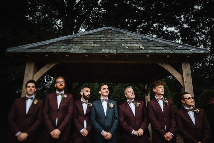 Groomsmen in Navy and Burgundy Suits and Bow Ties