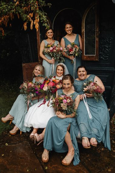 Bride and Bridesmaid Portrait at Askham Hall Wedding with Jade Green Dresses and Pink Wedding Bouquets