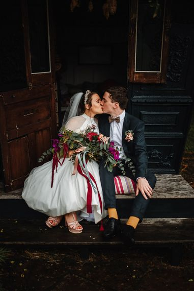 Bride and Groom Kissing at Their Askham Hall Wedding