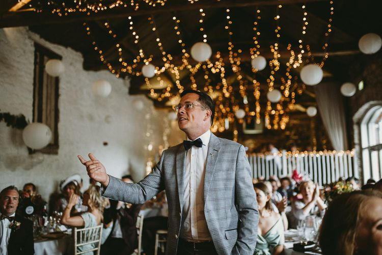 Wedding Guest in Check Blazer and Bow Tie at Askham Hall Wedding