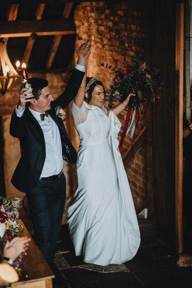 Bride and Groom Entering their Askham Hall Wedding Reception