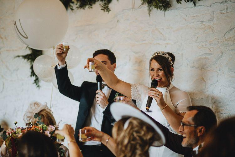 Bride and Groom Shot Toast at Askham Hall Wedding Reception