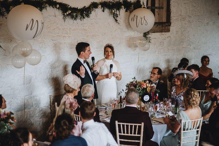 Bride and Groom Delivering the Wedding Speech Together