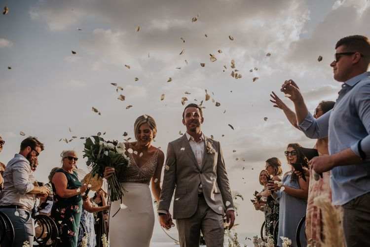 Confetti exit for bride and groom at intimate Thailand wedding