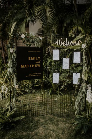 Wedding seating chart with foliage and leaf decor for industrial jungle chic Thailand wedding