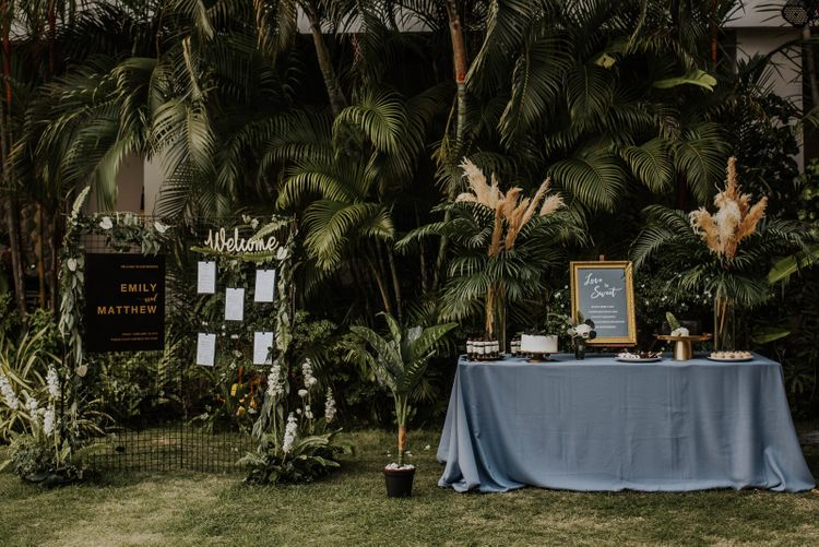 Beautiful Thailand wedding decor with pampas grass and treat table