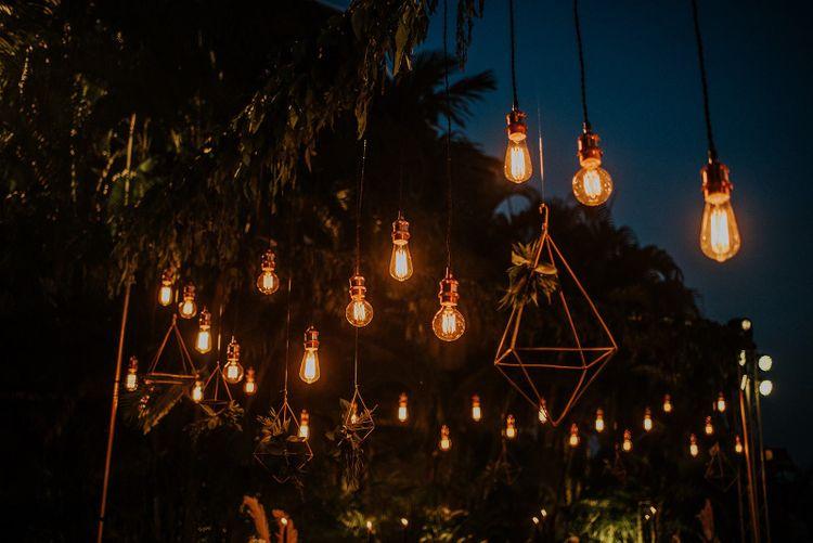 Hanging light installation at intimate destination Thailand wedding