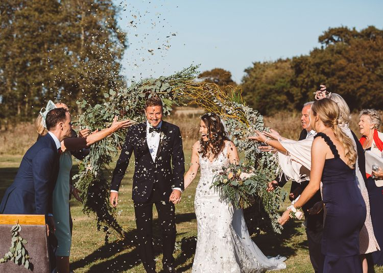 Eucalyptus leaf heart shaped confetti at intimate ceremony with seven guests