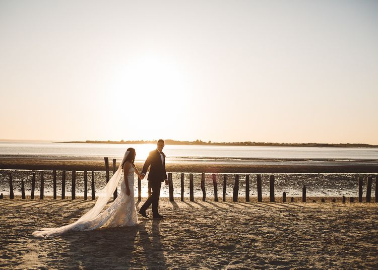 Bride and groom enjoy a beach shoot together at golden hour