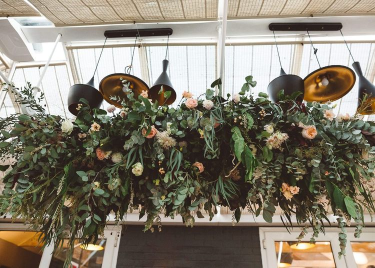 Beautiful hanging foliage styled with eucalyptus for a romantic and intimate dinner at Crouchers Orchards