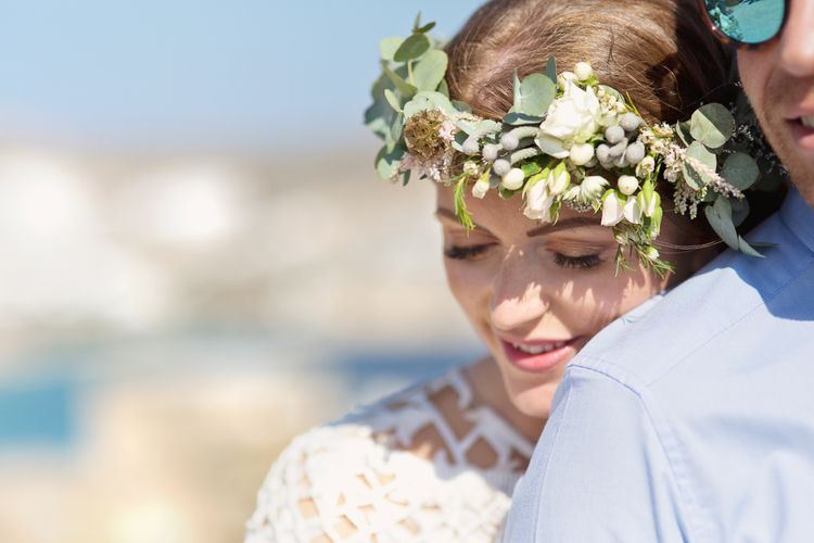 Boho Bride in White and Green Flower Crown Resting on Her Grooms Shoulder