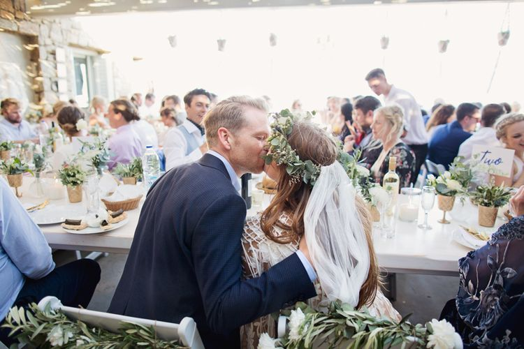 Bride and Groom Kissing at Outdoor Wedding Reception